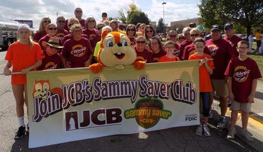 JCB's Sammy Saver with people at a parade